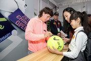 Carla Suarez Navarro of Spain signs autographs at the Offical Merchandise Booth during the 2018 China Open at the China National Tennis Centre on September 30, 2018 in Beijing, China.