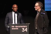 Barry Jenkins and Gordon Quinn speak onstage during the 2018 IDA Documentary Awards on December 8, 2018 in Los Angeles, California.