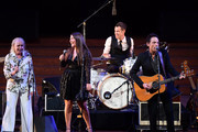 """Michelle Phillips, Jade Castrinos, and Jakob Dylan perform during the 2018 LA Film Festival opening night premiere of """"Echo In The Canyon"""" at John Anson Ford Amphitheatre on September 20, 2018 in Hollywood, California."""