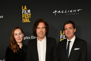 """Jennifer Cochis, Andrew Slater and Josh Welsh attends the 2018 LA Film Festival opening night premiere of """"Echo In The Canyon"""" at John Anson Ford Amphitheatre on September 20, 2018 in Hollywood, California."""