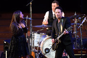 "Jade Castrinos and Jakob Dylan perform during the 2018 LA Film Festival opening night premiere of ""Echo In The Canyon"" at John Anson Ford Amphitheatre on September 20, 2018 in Hollywood, California."