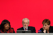 Shadow Home Secretary Diane Abbott (L), Labour Party leader Jeremy Corbyn (C) and Shadow Foreign Secretary Emily Thornberry (R) watch a video presentation from their seats onstage in the Exhibition Centre Liverpool, during day three of the annual Labour Party conference, on September 25, 2018 in Liverpool, England. Labour's official slogan for the conference is 'Rebuilding Britain, for the many, not the few.'
