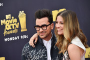 Actors Dan Levy and Annie Murphy attend the 2018 MTV Movie And TV Awards at Barker Hangar on June 16, 2018 in Santa Monica, California.