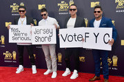 (L-R) TV personalities DJ Pauly D, Vinny Guadagnino, Mike 'The Situation' Sorrentino, and Ronnie Ortiz-Magro attend the 2018 MTV Movie And TV Awards at Barker Hangar on June 16, 2018 in Santa Monica, California.