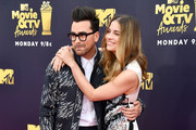 Actors Dan Levy (L) and Annie Murphy attend the 2018 MTV Movie And TV Awards at Barker Hangar on June 16, 2018 in Santa Monica, California.