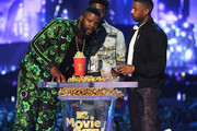 (L-R) Actors Winston Duke, Chadwick Boseman, and Michael B. Jordan accept the Best Movie award (Presented by Toyota) for 'Black Panther' onstage during the 2018 MTV Movie And TV Awards at Barker Hangar on June 16, 2018 in Santa Monica, California.