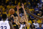 Stephen Curry #30 of the Golden State Warriors attempts to pass around LeBron James #23, Jordan Clarkson #8 and Larry Nance Jr. #22 of the Cleveland Cavaliers in Game 1 of the 2018 NBA Finals at ORACLE Arena on May 31, 2018 in Oakland, California. NOTE TO USER: User expressly acknowledges and agrees that, by downloading and or using this photograph, User is consenting to the terms and conditions of the Getty Images License Agreement.