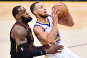 Stephen Curry #30 of the Golden State Warriors goes up against LeBron James #23 of the Cleveland Cavaliers during Game Three of the 2018 NBA Finals at Quicken Loans Arena on June 6, 2018 in Cleveland, Ohio. NOTE TO USER: User expressly acknowledges and agrees that, by downloading and or using this photograph, User is consenting to the terms and conditions of the Getty Images License Agreement.