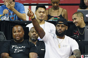 Randy Mims (L) and LeBron James of the Los Angeles Lakers react after a dunk by Johnathan Williams #21 of the Lakers against the Detroit Pistons during quarterfinal game of the 2018 NBA Summer League at the Thomas & Mack Center on July 15, 2018 in Las Vegas, Nevada. NOTE TO USER: User expressly acknowledges and agrees that, by downloading and or using this photograph, User is consenting to the terms and conditions of the Getty Images License Agreement.