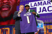 Lamar Jackson of Louisville poses with NFL Commissioner Roger Goodell after being picked #32 overall by the Baltimore Ravens during the first round of the 2018 NFL Draft at AT&T Stadium on April 26, 2018 in Arlington, Texas.
