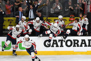 (L-R) Devante Smith-Pelly #25, Jay Beagle #83, Andre Burakovsky #65, T.J. Oshie #77, Jakub Vrana #13, Chandler Stephenson #18, Nicklas Backstrom #19 and Alex Ovechkin #8 of the Washington Capitals jump the boards as they celebrate the team's 4-3 win over the Vegas Golden Knights in Game Five of the 2018 NHL Stanley Cup Final at T-Mobile Arena on June 7, 2018 in Las Vegas, Nevada.