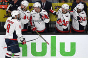 (L-R) Alex Ovechkin #8 of the Washington Capitals celebrates with teammates on the bench Tom Wilson #43, Andre Burakovsky #65, Jay Beagle #83 and Devante Smith-Pelly #25 after Ovechkin scored a second-period, power-play goal against the Vegas Golden Knights in Game Five of the 2018 NHL Stanley Cup Final at T-Mobile Arena on June 7, 2018 in Las Vegas, Nevada. The Capitals defeated the Golden Knights 4-3.