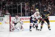 Braden Holtby #70 of the Washington Capitals tends net as teammate Dmitry Orlov #9 battles with Alex Tuch #89 of the Vegas Golden Knights during the first period in Game Five of the 2018 NHL Stanley Cup Final at T-Mobile Arena on June 7, 2018 in Las Vegas, Nevada. The Capitals defeated the Golden Knights 4-3.
