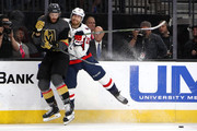 Colin Miller #6 of the Vegas Golden Knights is checked by Lars Eller #20 of the Washington Capitals during the first period in Game Five of the 2018 NHL Stanley Cup Final at T-Mobile Arena on June 7, 2018 in Las Vegas, Nevada.