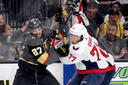 Shea Theodore #27 of the Vegas Golden Knights and T.J. Oshie #77 of the Washington Capitals get tied up during the first period in Game One of the 2018 NHL Stanley Cup Final at T-Mobile Arena on May 28, 2018 in Las Vegas, Nevada.