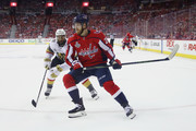 Lars Eller #20 of the Washington Capitals skates against Pierre-Edouard Bellemare #41 of the Vegas Golden Knights in Game Three of the 2018 NHL Stanley Cup Final at Capital One Arena on June 2, 2018 in Washington, DC.