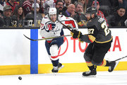 T.J. Oshie #77 of the Washington Capitals and Shea Theodore #27 of the Vegas Golden Knights chase down a loose puck during the third period in Game Two of the 2018 NHL Stanley Cup Final at T-Mobile Arena on May 30, 2018 in Las Vegas, Nevada. The Capitals defeated the Golden Knights 3-2.