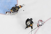 A shot by Brooks Orpik (not pictured) #44 of the Washington Capitals hits Alex Tuch #89 of the Vegas Golden Knights and bounces off the ice past Marc-Andre Fleury #29 of the Golden Knights for a goal as Brett Connolly #10 of the Capitals looks on in the second period of Game Two of the 2018 NHL Stanley Cup Final at T-Mobile Arena on May 30, 2018 in Las Vegas, Nevada. The Capitals defeated the Golden Knights 3-2.