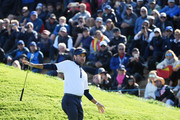 Bubba Watson of the United States recats after playing their fourth shot on the ninth during the afternoon foursome matches of the 2018 Ryder Cup at Le Golf National on September 29, 2018 in Paris, France.