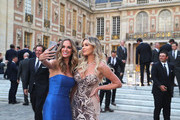 Brooks Koepka's partner, Jena Sims, takes a selfie with Dustin Johnson's partner, Paulina Gretzky, before the Ryder Cup gala dinner at the Palace of Versailles ahead of the 2018 Ryder Cup on September 26, 2018 in Versailles, France.