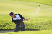 Rickie Fowler of the United States plays out of a bunker on the ninth during the morning fourball matches of the 2018 Ryder Cup at Le Golf National on September 29, 2018 in Paris, France.