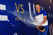 Henrik Stenson of Europe sprays champagne as he celebrates after winning The Ryder Cup following the singles matches of the 2018 Ryder Cup at Le Golf National on September 30, 2018 in Paris, France.