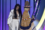 SZA (L) presents the Legend Award to Erykah Badu onstage during the 2018 Soul Train Awards at the Orleans Arena on November 17, 2018 in Las Vegas, Nevada.