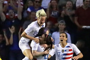 (L-R) Megan Rapinoe #15, , Rose Lavelle #16  Alex Morgan #13 and  Tobin Heath #17 of the United States celebrate Lavells goal against Brazil during the 2018 Tournament Of Nations at Toyota Park on August 2, 2018 in Bridgeview, Illinois.