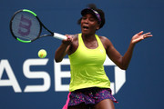 Venus Williams of the United States returns the ball during her women's singles first round match against Svetlana Kuznetsova of Russia on Day One of the 2018 US Open at the USTA Billie Jean King National Tennis Center on August 27, 2017 in the Flushing neighborhood of the Queens borough of New York City.