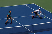 Jamie Murray of Great Britain and partner Bruno Soares of Brazil return the ball during their men's doubles quarter-final match against Malek Jaziri of Tunisia and Radu Albot of Moldova on Day Ten of the 2018 US Open at the USTA Billie Jean King National Tennis Center on September 5, 2018 in the Flushing neighborhood of the Queens borough of New York City.