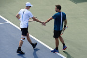 Jamie Murray of Great Britain and Bruno Soares of Brazil talk against Guido Pella of Argentina and Albert Ramos-Vinolas of Spain during the men's doubles first round match on Day Four of the 2018 US Open at the USTA Billie Jean King National Tennis Center on August 30, 2018 in the Flushing neighborhood of the Queens borough of New York City.