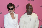 Kris Jenner and Corey Gamble attend the 2018 Victoria's Secret Fashion Show at Pier 94 on November 08, 2018 in New York City.