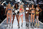 (L-R) Maggie Laine, Zuri Tibby, Josie Canseco, Subah Koj, Georgia Fowler, and Mayowa Nicholas walk the runway during the 2018 Victoria's Secret Fashion Show at Pier 94 on November 8, 2018 in New York City.