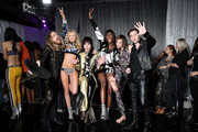 (L-R) Adam Slack, Maggie Laine, Luke Spiller, Zuri Tibby, Gethin Davies and Jed Elliott pose backstage during the 2018 Victoria's Secret Fashion Show at Pier 94 on November 8, 2018 in New York City.