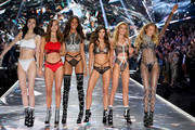 (L-R) Ming Xi, Grace Elizabeth, Cindy Bruna, Sara Sampaio, Stella Maxwell, and Romee Strijd walk the runway during the 2018 Victoria's Secret Fashion Show at Pier 94 on November 8, 2018 in New York City.