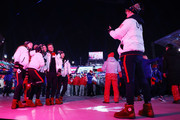 United States' athletes Bradie Tennell, Madison Chock, Adam Rippon, Gus Kenworthy and Mirai Nagasu have their photo taken by Evan Bates during the Closing Ceremony of the PyeongChang 2018 Winter Olympic Games at PyeongChang Olympic Stadium on February 25, 2018 in Pyeongchang-gun, South Korea.