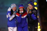 (L-R) Silver medalist Krista Parmakoski of Finland, gold medalist Marit Bjorgen of Norway and bronze medalist Stina Nilsson of Sweden poses during the medal ceremony for the Cross-Country Skiing - Ladies' 30km Mass Start Classic during the Closing Ceremony of the PyeongChang 2018 Winter Olympic Games at PyeongChang Olympic Stadium on February 25, 2018 in Pyeongchang-gun, South Korea.