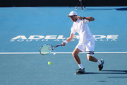 Mike Bryan of the USA competes in his match against Jamie Murray of Great Britain and Bruno Soares of Brazil on day two of the 2018 World Tennis Challenge at Memorial Drive on January 9, 2018 in Adelaide, Australia.