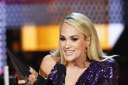 Carrie Underwood accepts the Favorite Album - Country award for 'Cry Pretty' and Favorite Female Artist - Country award onstage during the 2019 American Music Awards at Microsoft Theater on November 24, 2019 in Los Angeles, California.