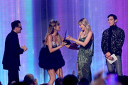 Taylor Swift accepts the Favorite Album - Pop/Rock award for 'Lover' performs onstage during the 2019 American Music Awards at Microsoft Theater on November 24, 2019 in Los Angeles, California.