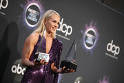 Carrie Underwood poses in the press room with the Favorite Album - Country and the Favorite Female Artist - Country awards during the 2019 American Music Awards at Microsoft Theater on November 24, 2019 in Los Angeles, California.
