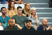 Jamie Murray (middle centre) and Judy Murray (middle right) look on as Andy Murray of Great Britain plays in his first round match against Roberto Bautista Agut of Spain during day one of the 2019 Australian Open at Melbourne Park on January 14, 2019 in Melbourne, Australia.