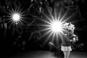 Image has been converted to black and white.) Naomi Osaka of Japan poses for a photo with the Daphne Akhurst Memorial Cup following victory in her Women's Singles Final match against Petra Kvitova of the Czech Republic during day 13 of the 2019 Australian Open at Melbourne Park on January 26, 2019 in Melbourne, Australia.