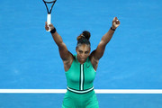 Serena Williams of the United States celebrates winning match point in her fourth round match against Simona Halep of Romania during day eight of the 2019 Australian Open at Melbourne Park on January 21, 2019 in Melbourne, Australia.