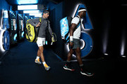 Frances Tiafoe of the United States and Rafael Nadal of Spain walk onto Rod Laver Arena before their quarter final match during day nine of the 2019 Australian Open at Melbourne Park on January 22, 2019 in Melbourne, Australia.