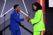 (L-R) Jacob Latimore presents the Coca-Cola Viewers' Choice Award to Ella Mai for 'Trip' onstage at the 2019 BET Awards on June 23, 2019 in Los Angeles, California.