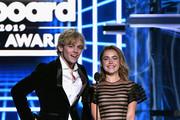 (L-R) Ross Lynch and Kiernan Shipka speak onstage during the 2019 Billboard Music Awards at MGM Grand Garden Arena on May 1, 2019 in Las Vegas, Nevada.