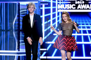 (L-R) Ross Lynch and Kiernan Shipka speak onstage during the 2019 Billboard Music Awards at MGM Grand Garden Arena on May 01, 2019 in Las Vegas, Nevada.