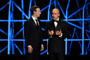 Mark Zuckerberg and Yuri Milner onstage at the 2019 Breakthrough Prize at NASA Ames Research Center on November 4, 2018 in Mountain View, California.