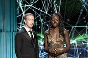Mark Zuckerberg and Lupita Nyong'o speak onstage at the 2019 Breakthrough Prize at NASA Ames Research Center on November 4, 2018 in Mountain View, California.